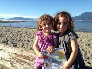 Whoa! Joe with friends - Morgan & Olivia at Spanish Banks beach, overlooking the North Shore Mountains in Vancouver.